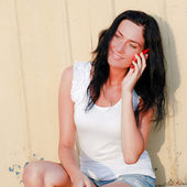 Young beautiful woman talking on mobile phone — Stock Photo