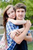 Young happy smiling couple embracing — Foto Stock