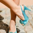 Beautiful woman legs in blue high heel shoes — Stock Photo #15839919