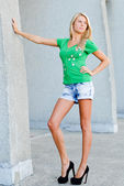 Young beautiful blonde woman wearing black high heel shoes — Stock Photo