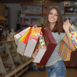 Happy young womwith shopping bags — Foto de stock #18059909