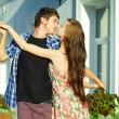 Young happy couple dancing outdoors — Foto Stock