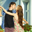 Young happy couple dancing outdoors - Stock Photo