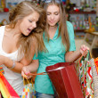Two happy young women with shopping bags — Stock Photo #18240975