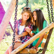 Two young girl friends looking on mobile phone — Stock fotografie
