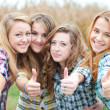Four happy teen girls friends showing okay — Stock Photo