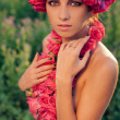 Young beautiful model with rose crown — Stock Photo