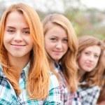 Four happy teenage friends — Stock Photo