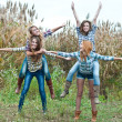 Four happy teen girls friends having fun outdoors — Stok fotoğraf