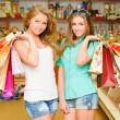 Two happy young women with shopping bags — Stock Photo #18249181