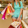 Happy young womwith shopping bags — Stock Photo #18249219