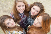 Four happy teen girls friends — Stock Photo