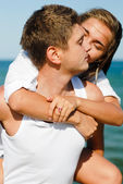 Young happy vouple kissing by the sea — Stock Photo