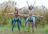 Four happy teen girls friends having fun outdoors — Stock Photo