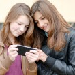 Two teen girls looking on tablet pc — Stock Photo