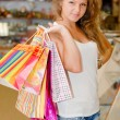 Happy young womwith shopping bags — Foto de stock #18524887