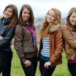 Four happy teenage friends — Stok fotoğraf