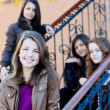 Four happy teen girls friends — Stockfoto