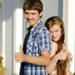 Young happy couple showing thumbs up — Stock Photo #18822527
