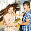 Young happy couple dancing on street - Stock Photo