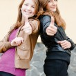 Two young girl friends showing okay — Stock Photo