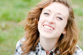 Smiling teenage girl had shot portrait — Stock Photo