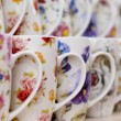 Many white coffee or tea mugs in a line for sale — Stock Photo