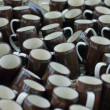 Many brown coffee mugs in a line for sale — Stock Photo