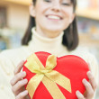 Happy woman and red gift box — Stock Photo