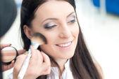 Young woman at make up artist — Stock Photo