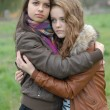 Two Young Beautiful Teen Girls friendly Hug — Stock Photo #21262087