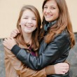 Stock Photo: Friendship - Two best girlfriends hugging eachother