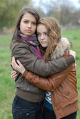 Two Young Beautiful Teen Girls friendly Hug — Stock Photo