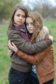 Two Young Beautiful Teen Girls friendly Hug — Stock Photo