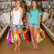 Two happy young women with shopping bags — Stok fotoğraf