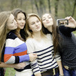 Four teen girls taking picture of themselves — 图库照片