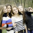 Four teen girls taking picture of themselves - Stock Photo