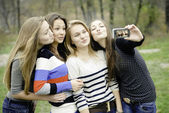 Four teen girls taking picture of themselves — Stock Photo