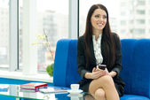 Young business woman speaking holding mobile — Stock Photo