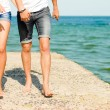 Young happy couple on the sea coast - Stock Photo