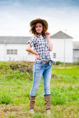 Pretty smiling happy teenage girl in cowboy hat — Stock fotografie