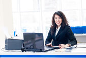 Successful smiling woman at office with pc screen — Stok fotoğraf