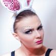 Easter bunny female looking serious for easter eggs — Stock Photo