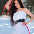 Sensual young beautiful brunette in snowy forest — Stock Photo