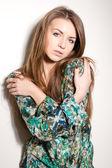 Fashion girl portrait on a white background — Stock Photo