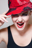 Elegant young woman with red hat — Stock Photo
