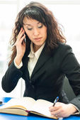 Successful woman at office workplace — Stok fotoğraf