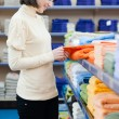 Pretty young woman shopping towels — Stock Photo