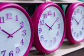 Wall clocks on the shelf — Stock Photo
