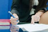 Closeup on woman hand write by pen — Stock Photo